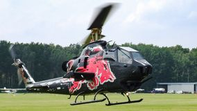 Bell Cobra TAH-1F of The Flying Bulls taking off in Goraszka in Poland. Military helicopter Bell Cobra TAH-1F of The Flying Bulls taking off in Goraszka airfield Stock Photo