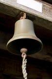 Bell colgante con la cuerda de la chapaleta Imagen de archivo libre de regalías