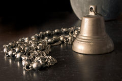 Bell and costume jewelery Royalty Free Stock Photos