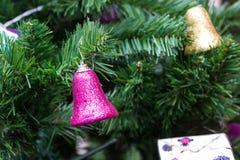 Bell on cristmas tree Stock Photo