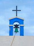 Bell and cross of a canarian church Stock Photography