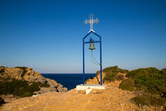 Bell and Cross on Telendos Island. View over the Mediterranean from a mountain on Telendos Island, Greece Royalty Free Stock Photo