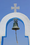 Bell and cross of a typical greek church Stock Photo