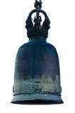 Bell d'ottone sui precedenti bianchi Fotografia Stock