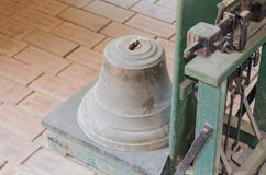 Bell on decimal scale. Bell is weighed on an old antique decimal scale royalty free stock image