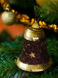 Bell decoration on Christmas tree Royalty Free Stock Photography