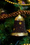 Bell decoration on Christmas tree Royalty Free Stock Photos