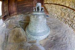 Bell at the entrance of the church of St. Nicholas in Zheravna Stock Image