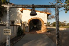 Bell at the entrance to the portals of the Mission in San Juan Bautista, California, USA. royalty free stock photography
