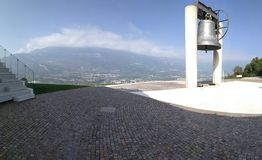 The Bell of the Fallen, Rovereto, Italy. Biggest Bell in the world with beutiful panoratic foto royalty free stock images