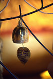 Bell-Golden bell and the pho leaf at in Buddha temple Stock Photos