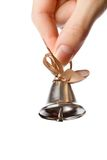 Bell in hand Stock Image