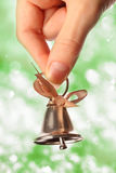Bell in hand Royalty Free Stock Image