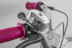 Bell on handlebar of cycle Royalty Free Stock Image