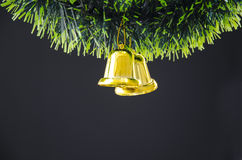 Bell hang on Christmas tree Royalty Free Stock Photos