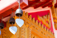 Bell hanging from the temple roof. Brass bell hanging from the asian temple roof Stock Photo