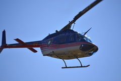 Bell-206 helicopter blue sky Royalty Free Stock Image