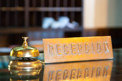 Bell in hotel reception. Golden bell on  reception desk in hotel Royalty Free Stock Photography