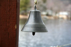 Bell by the Lake. Silver Bell ready to ring royalty free stock photo
