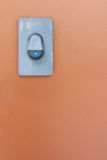 Bell light. The bell in front of the wall of my house Stock Photography