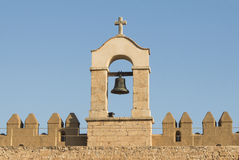 Bell in a medieval castle in Spain, Andalusia. Stock Photos
