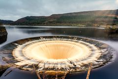 Bell mouth Overflow Plug Hole at Ladybower Reservoir royalty free stock images