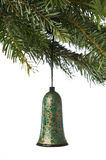 Bell ornament hanging from a Christmas tree Royalty Free Stock Images