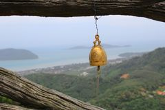 Bell Over Phuket Island. Golden Bell with a view over Phuket Island Stock Photos