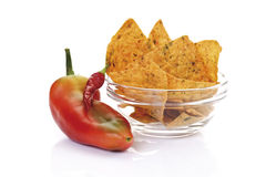 Bell pepper by bowl of nacho chips Stock Photo