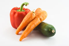 Bell pepper, carots and zucchini. Bell pepper, carrot and zucchini isolated on white Royalty Free Stock Photo