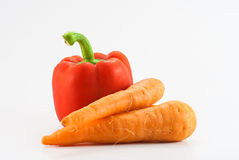 Bell pepper and carrot. Isolated on white Royalty Free Stock Photo