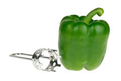 Bell pepper and carver tool Stock Photography