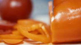 Bell pepper cut into Board, close-up. slow motion stock footage
