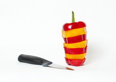 Bell pepper cut stacked with knife Royalty Free Stock Photography