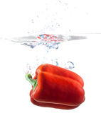 Bell Pepper Dropping Into Water Royalty Free Stock Photos