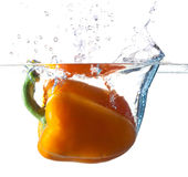 Bell Pepper Dropping Into Water Royalty Free Stock Photography