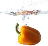 Bell Pepper Dropping Into Water Royalty Free Stock Photo