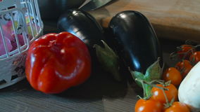 Bell Pepper And Eggplant On Wooden Table stock video