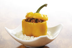 Bell pepper filled with minced meat on rice bed Stock Images