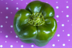 Bell pepper green on a purple polka dot surface Royalty Free Stock Images