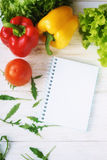 Bell pepper, green salad and notepad Royalty Free Stock Images