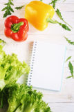 Bell pepper, green salad and notepad Stock Image