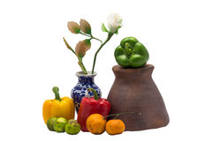 Bell pepper lemon orange mortar white plastic in vase still life. Picture picture royalty free stock photography