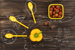 Bell pepper lying near bright yellow spoons Stock Photography