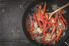 Bell pepper and onion frying in the pan top view Royalty Free Stock Image