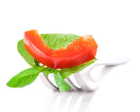 Bell pepper slice and leaf of basil Stock Images
