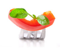 Bell pepper slice and leaf of spinach on fork Royalty Free Stock Image
