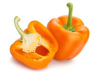 Bell pepper. Sliced orange bell pepper on white background royalty free stock image