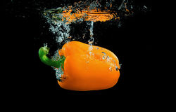 Bell pepper with splashes. Bell pepper on black background with splashes Stock Photos