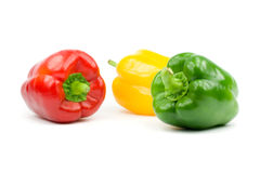 Bell peppers. Three bell peppers. Isolated on white Stock Photos